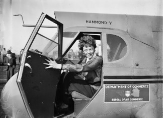 Amelia Earhart on her plane - Amelia Earhart Facts For Kids
